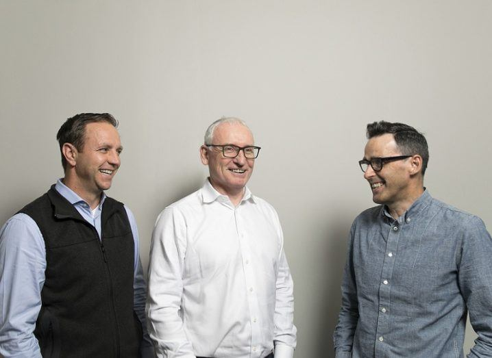 Utmost's Dan Beck, Annrai O'Toole and Paddy Benson stand together against a grey wall.