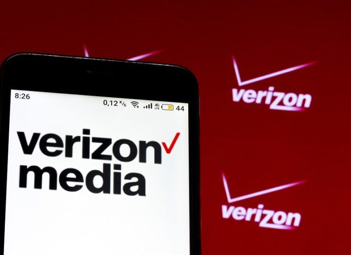 A phone screen showing the Verizon Media logo.