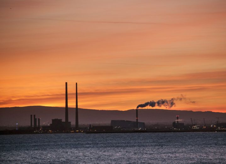 Sunset in Dublin bay, showing emissions coming from the Poolbeg incinerator.
