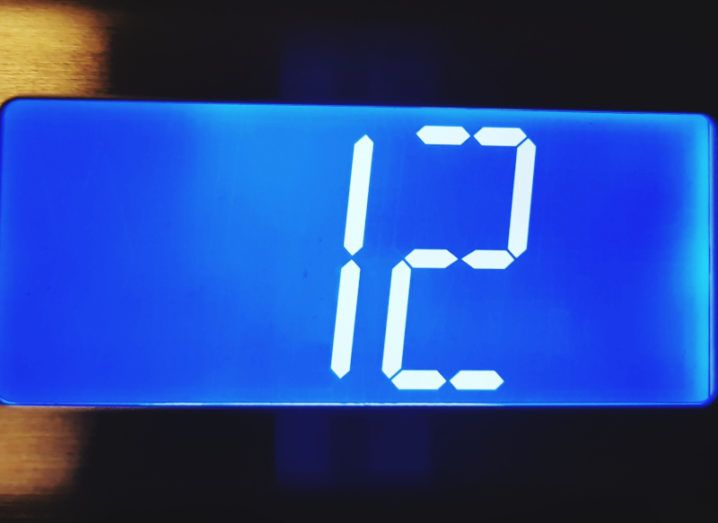 Close-up of a digital number 12 on an elevator display.