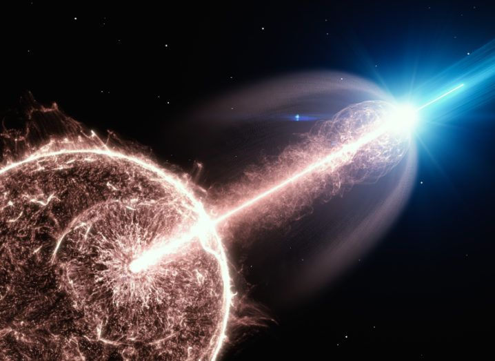 An artist's impression of a gamma-ray burst showing a ball of light with a line of light emerging from it against the blackness of space.