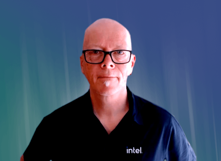 A man in a T-shirt that says Intel sits in front of a camera.