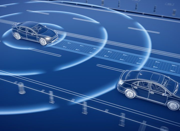 A graphic image of two self-driving cars following an automated path.