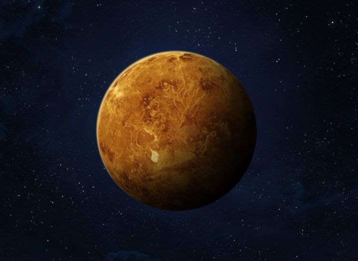 A rendering of the planet Venus, an orange planet against a black starry sky.