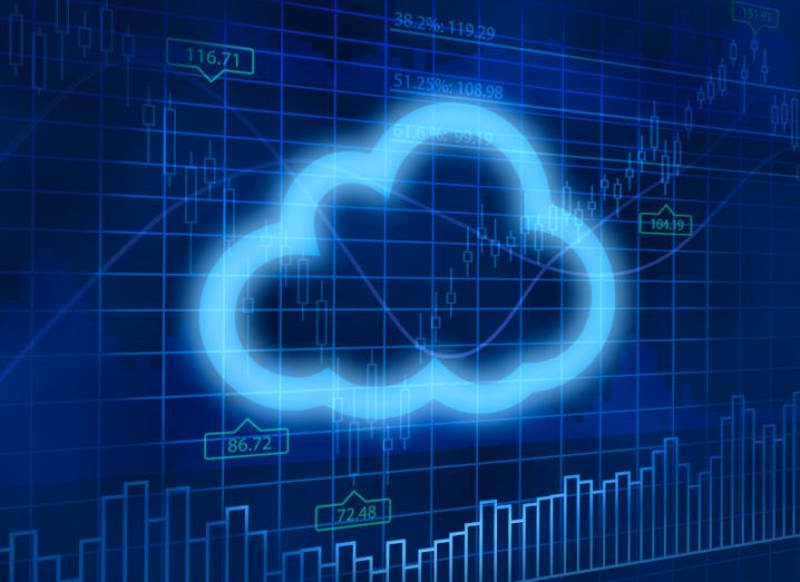 A neon blue cloud-shaped outline against a financial-style background with stock numbers on it, symbolising cloud market spending.