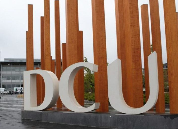 Large white letters spelling out DCU are part of a sculpture on the university campus.