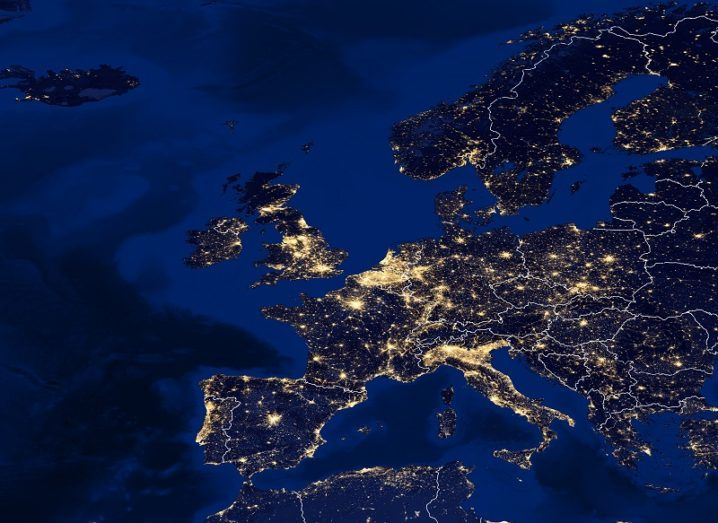 A map of Europe with cities lit up in bright lights.