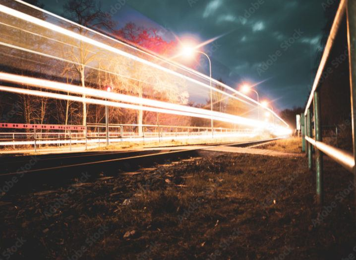 Night-time capture of a lit-up 5G railway network.