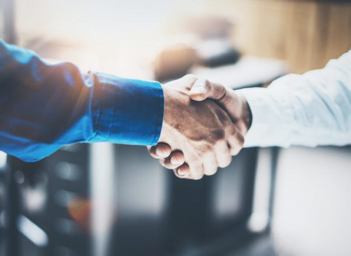 Close up view of a business partnership handshake between two people