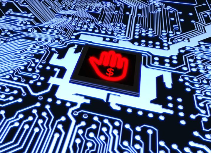 Illustration of computer circuitry disrupted by a red hand bearing a dollar sign, signifying that systems have been corrupted by ransomware.