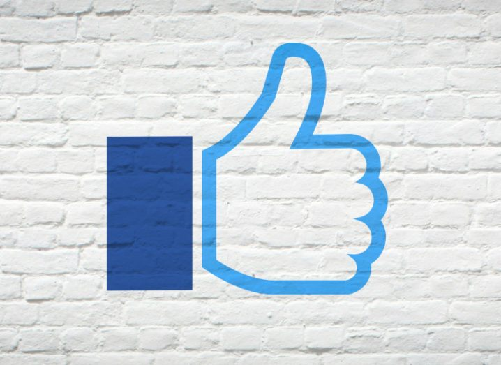 The Facebook 'like' symbol on a brick wall.