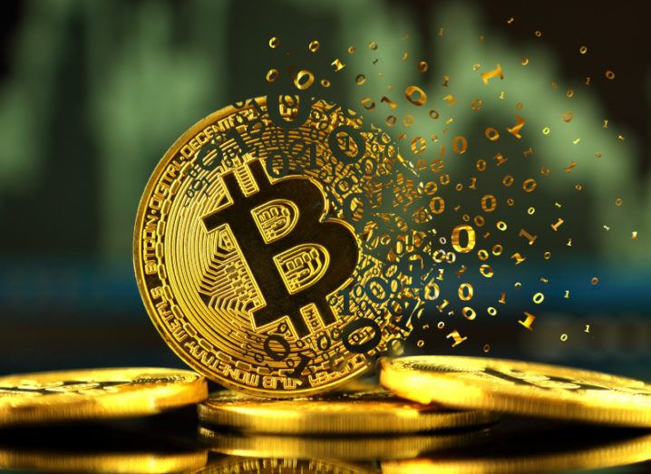 An illustration of a Bitcoin disintegrating into binary digits.