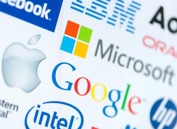 The logos of Google, Microsoft and Apple, nestled among other big tech company logos.