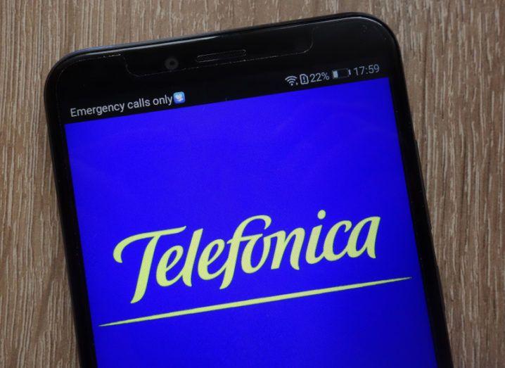 The Telefónica logo on a smartphone.