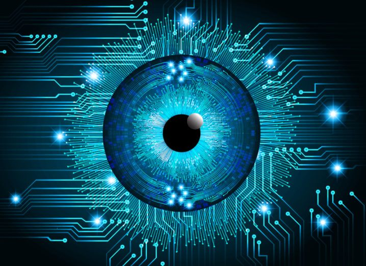Illustration showing the iris of an eye among the circuits of a computer chip.