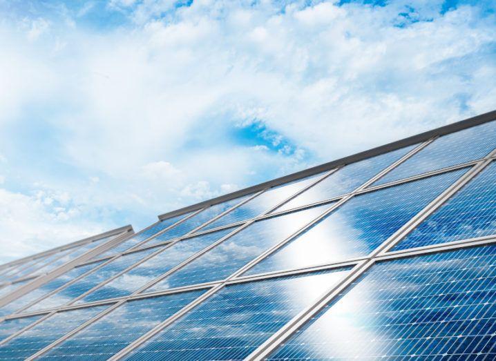 Solar panels overcast by a blue sky.
