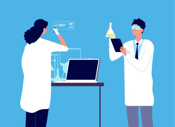 A cartoon graphic of two researchers. One is holding a tablet and a beaker of chemicals, while the other is working at a computer.