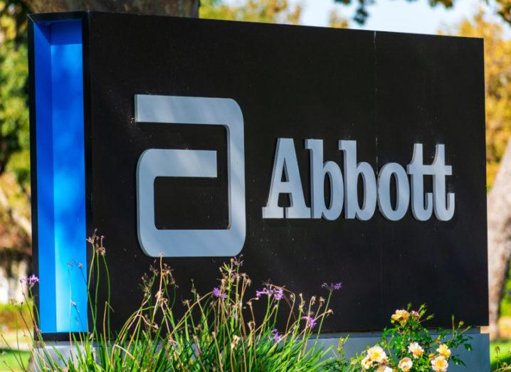 A sign outside an office that has the Abbott logo on it.