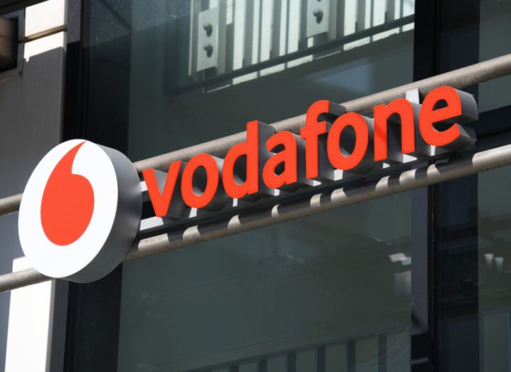 The Vodafone logo on a building.