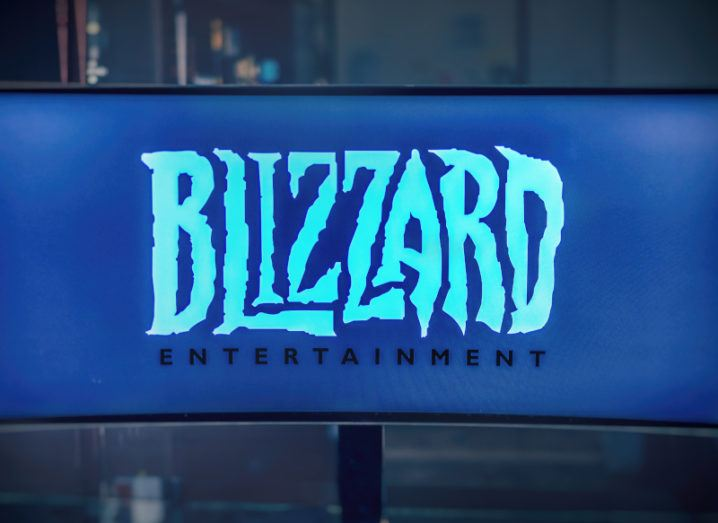 A monitor shows the logo of Blizzard Entertainment, which is a software producer of video games.