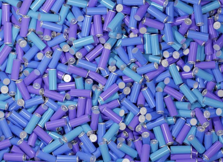 An expansive pile of batteries in blue and purple colours.