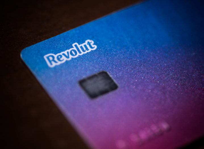 Close-up of a Revolut card with its blue and purple gradient.