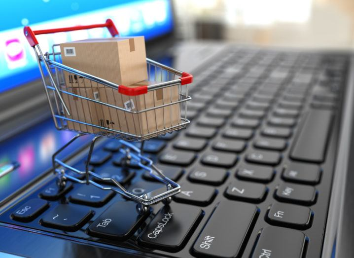 A graphic of a shopping cart on a laptop keyboard.