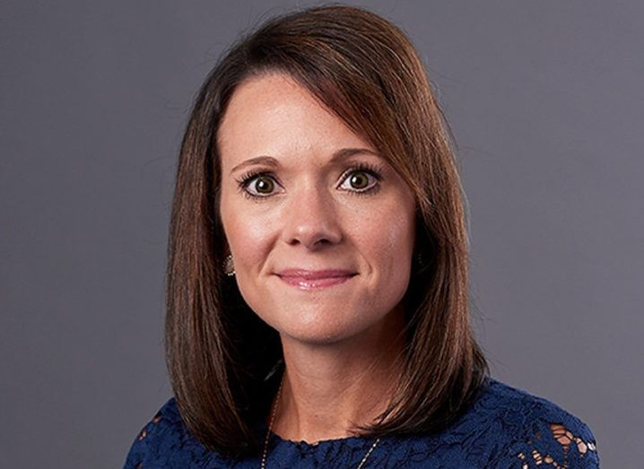 A close-up headshot of a woman smiling at the camera. She is Jadee Hanson, CIO and CISO of Code42.