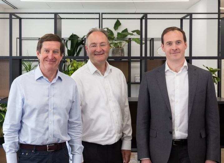 Draper Esprit's Martin Davis, Stuart Chapman and Ben Chapman stand in an office space.