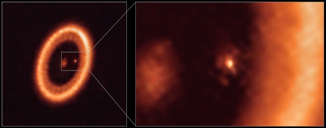 The PDS system is pictured on the left. The star is at the centre and PDS 70c can be seen to the right of the star. All of the bodies are orange, and the picture is primarily a large, circumstellar disc that surrounds the planets and the star. The right image is a zoomed-in shot of PDS 70c. It is small compared to the surrounding material which takes up much of the right-hand side of the image.
