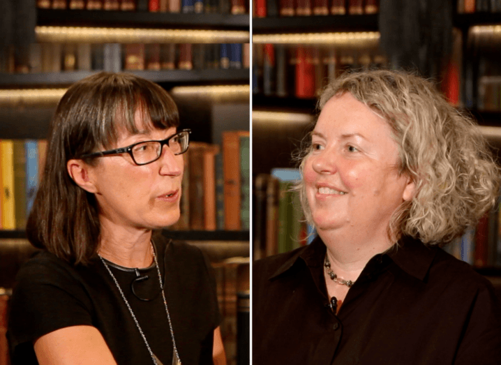 Ann O'Dea and Prof Linda Doyle in conversation in front of a well-stocked bookcase.