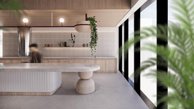 Une image rendue d'un espace de bureau commun avec une longue table et une unité de cuisine en arrière-plan.