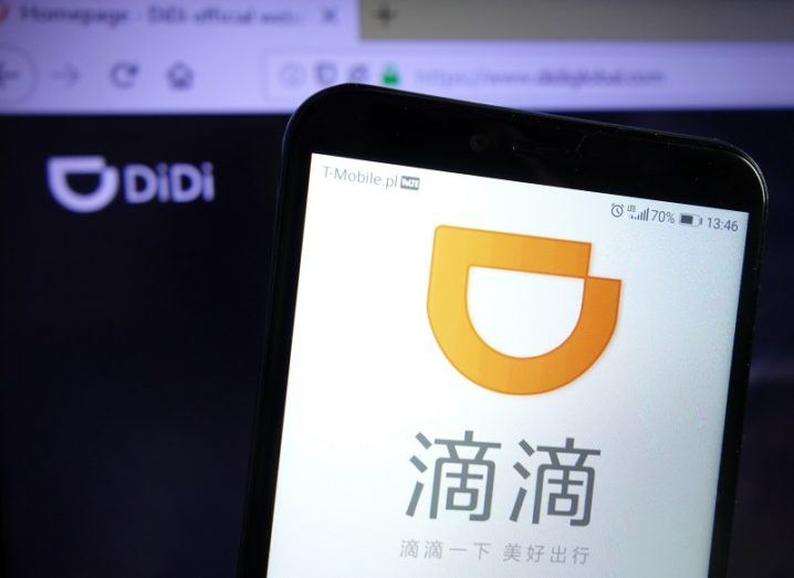 A phone with the Didi Chuxing app open on the screen.