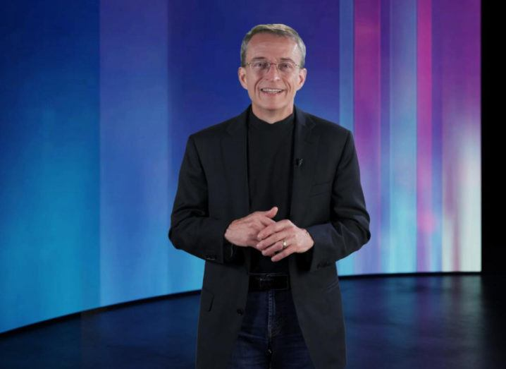 Pat Gelsinger dressed in black delivers a presentation for MWC against a colourful backdrop.