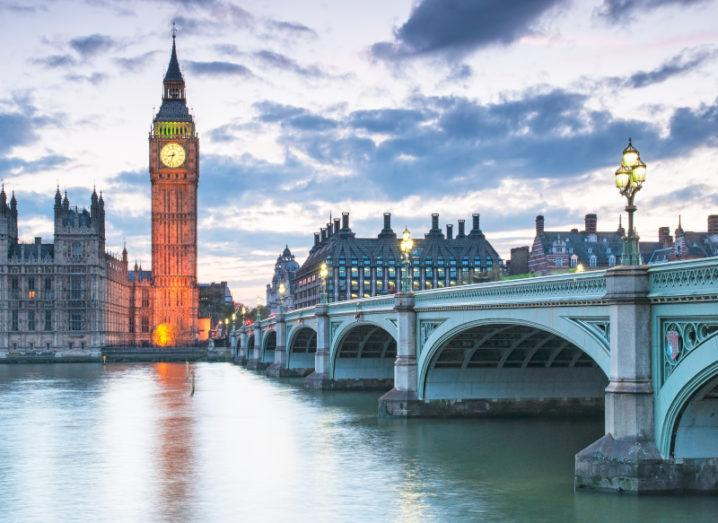 A picture of the River Thames in London at dusk, with Big Ben lit up in the background.