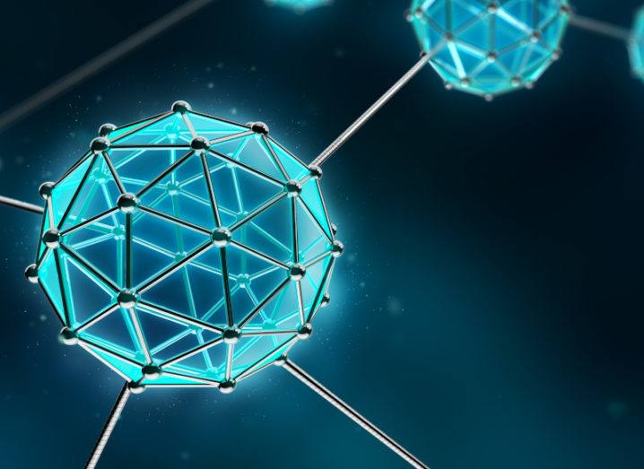 An artistic depiction of nanotechnology is shown. It is a sphere made from metal triangles. The faces of the triangles are a futuristic blue colour. Other spheres are connected by metal wires and can be seen in the background.