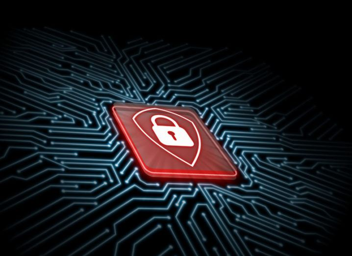 A red shield logo with a padlock symbol inside it on microchip with a glowing blue circuit board background.