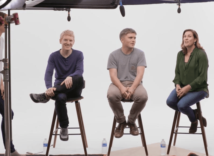 Stripe co-founders John and Patrick Collison giving an interview alongside the company's COO.
