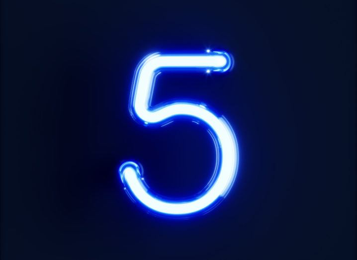Illustration of the number five in blue with a black background.