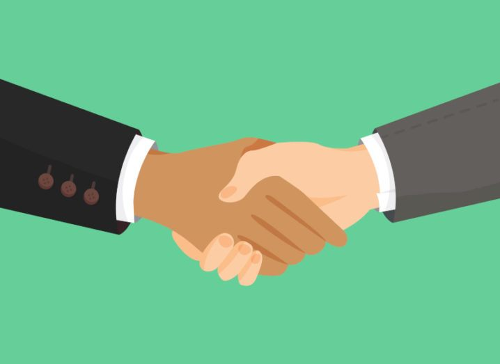 Graphic image of two hands shaking, agreeing on a deal.