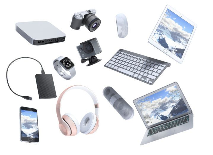 A collection of consumer electronics including a laptop, smartphone, headphones, tablet etc on a white background.
