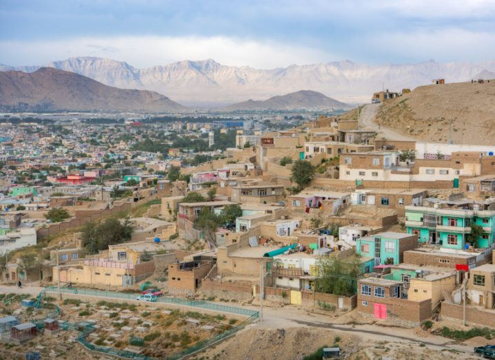 An aerial view of Kabul, Afghanistan, showing houses on the side of a hill.