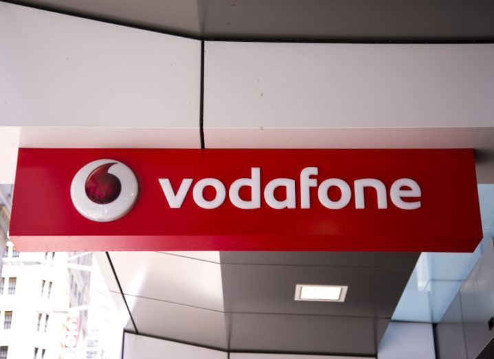 The Vodafone name and logo outside one of the company's stores.