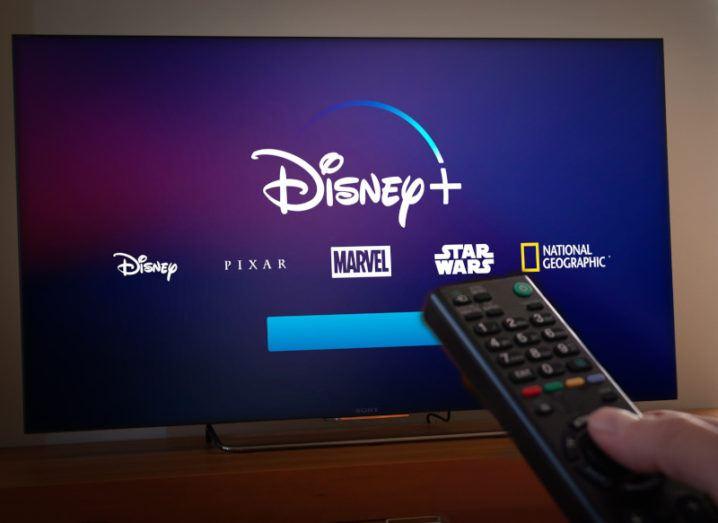 The Disney+ logo alongside the logo of several of Disney's media brands on a TV screen.