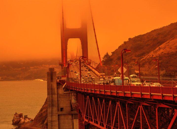 An orange glow fills the sky above the Golden Gate Bridge.