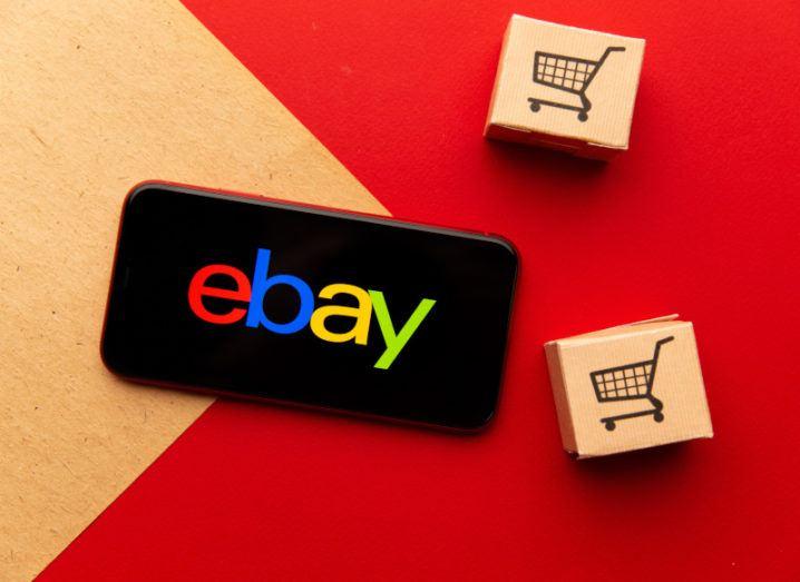 The eBay logo on a phone screen.