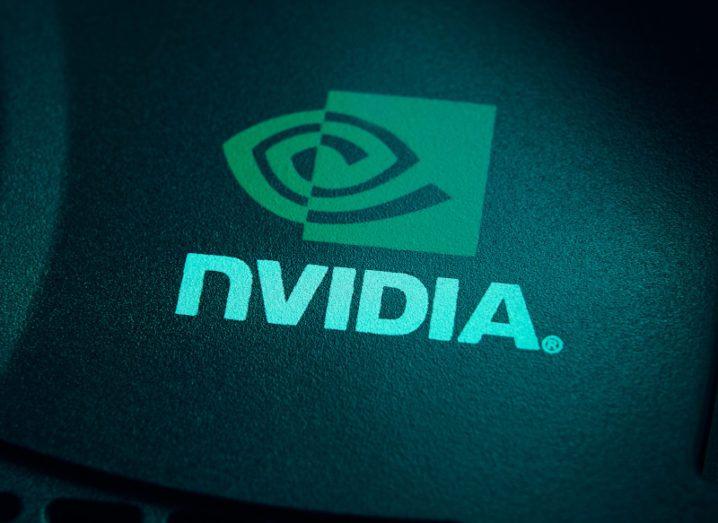 Tech company Nvidia logo bright green lit up against dark background.