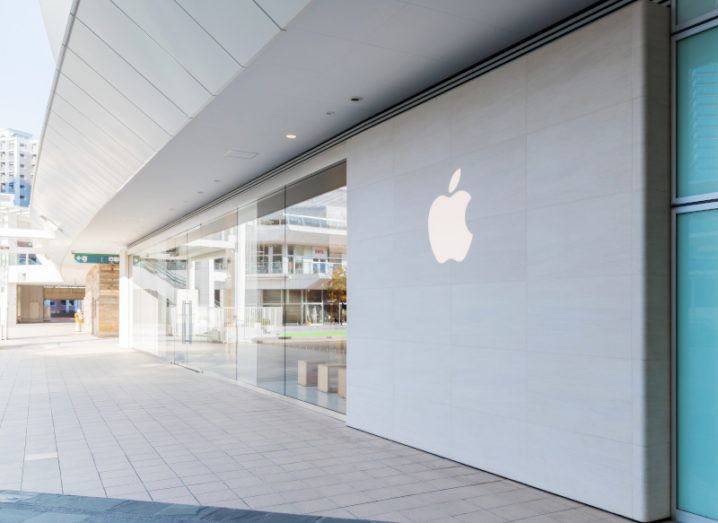 The Apple logo on the outside of a building.