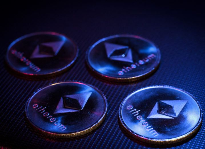 Coins imprinted with the Ethereum cryptocurrency emblem.