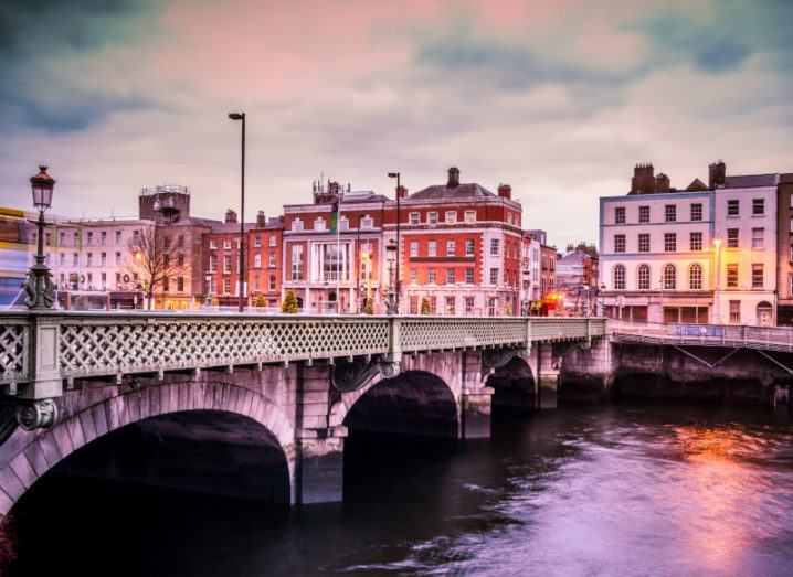 The Grattan Bridge over the River Liffey in Dublin at sunset.